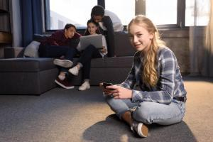 Teenagers in Living Room on Electronics