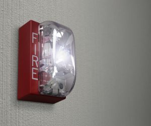 Fire Alarm Horn Strobe Flashing on Wall